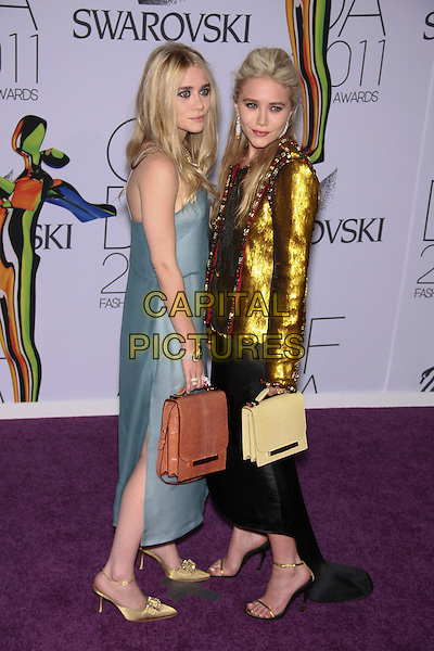 Ashley Olsen & Mary-Kate Olsen.The 2011 CFDA (Council of Fashion Designers of America) Fashion Awards at Alice Tully Hall - Lincoln Center, New York, NY, USA..June 6th, 2011.full length black blue gold dress strapless side bag purse handbag pink beige blazer metallic twins sisters siblings.CAP/LNC/TOM.©TOM/LNC/Capital Pictures.