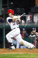 Carlos Lopez (18) of the Hagerstown Suns follows through on his swing against the Delmarva Shorebirds at Municipal Stadium on April 11, 2013 in Hagerstown, Maryland.  The Shorebirds defeated the Suns 7-4.  (Brian Westerholt/Four Seam Images)