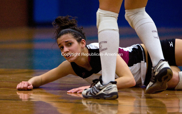 NEWINGTON, CT - 15 NOVEMBER 2008 -111508JT07-<br /> Torrington's Julia Giampaolo is approached by teammate Brooke Johnson after she dove for a ball that eventually went out of play during the Class L volleyball final against Darien at Newington on Saturday. Torrington lost to Darien 3-0.<br /> Josalee Thrift / Republican-American