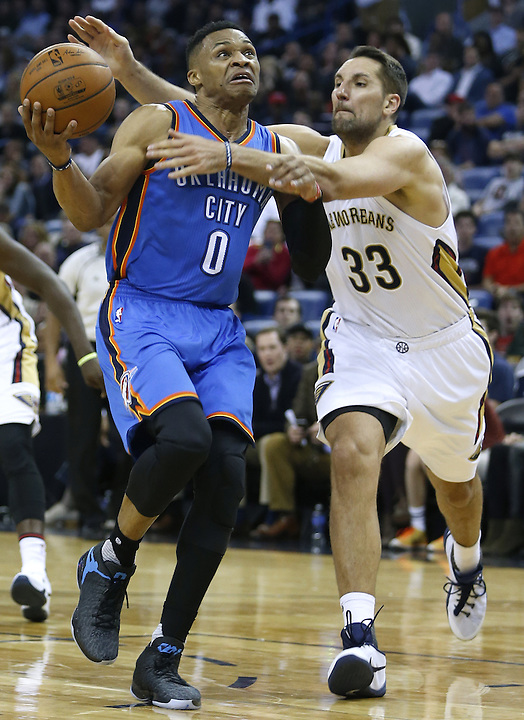 Oklahoma City Thunder guard Russell Westbrook (0) is fouled by New Orleans Pelicans forward Ryan Anderson (33) during the second half of an NBA basketball game Thursday, Feb. 25, 2016, in New Orleans. The Pelicans won 123-119. (AP Photo/Jonathan Bachman)