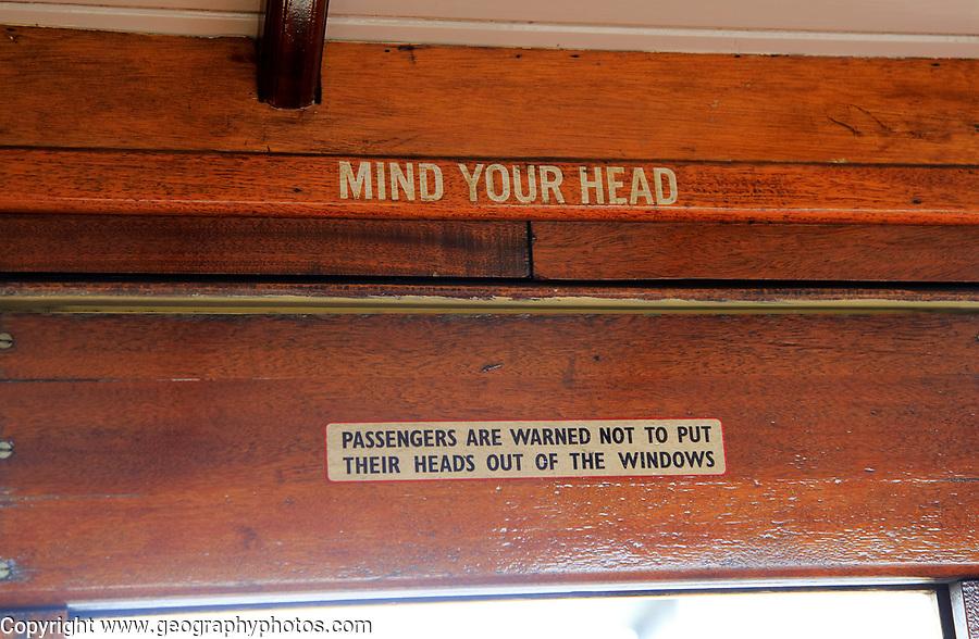 Mind Your Head sign inside train carriage of Ffestiniog railway, Gwynedd, north west Wales, UK