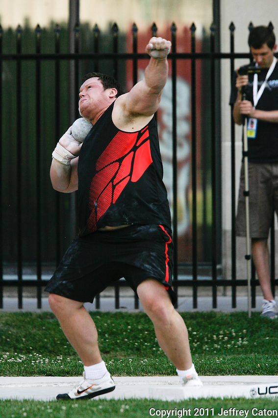 Dylan Armstrong competes in the men's Shot Put at Toronto International Track and Field Games held at the University of Toronto's Varsity Centre stadium, Wednesday July 13, 2011