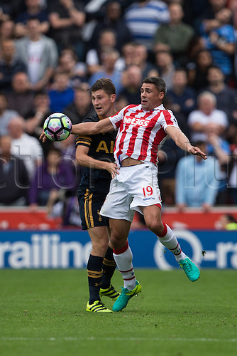 10.09.2016. Bet 365 Stadium, Stoke, England. Premier League Football. Stoke versus Tottenham Hotspur. Stoke City forward Jonathan Walters chests the ball down under pressure from Ben Davies (Spurs).