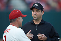 Umpire Olindo Mattia explains a call to North Carolina State Wolfpack head coach Elliott Avent (9) during the game against the Louisville Cardinals at Doak Field at Dail Park on March 24, 2017 in Raleigh, North Carolina. The Wolfpack defeated the Cardinals 3-1. (Brian Westerholt/Four Seam Images)