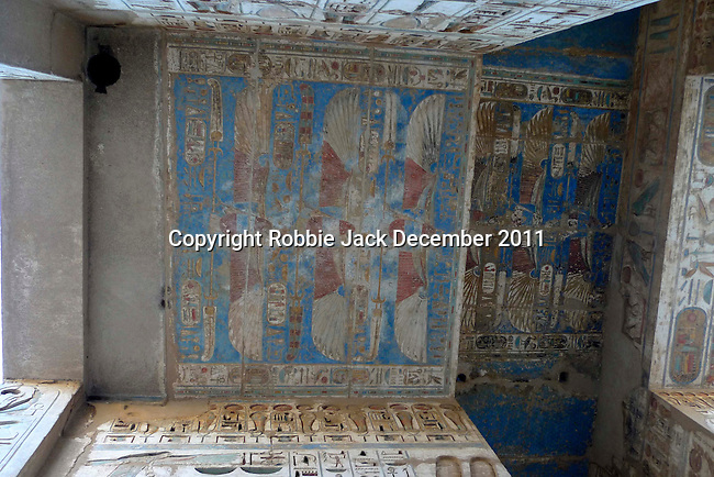 "The ceiling between the doorway from the  First Court to the Second Court at the mortuary temple of Ramses III at Medinet Habu at Thebes.Thebes was the ancient capital of Egypt and was built in and around modern day Luxor.The ancient name for Medinet Habu was Djamet meaning ""males and mothers."" Its holy ground was believed to be where the Ogdoad,the four pairs of primeval gods,were buried.Medinet Habu was both a temple and a complex of temples.Queen Hatshepsut who ruled Egypt from 1479-1458 BC  and Tuthmosis III who reigned from 1479-1425 BC built a small temple to Amun on the site of an earlier structure. Next to their temple, Ramses III who reigned from 1186-1155 BC built his mortuary temple.He then enclosed both structures within a massive mud-brick enclosure.The temple precinct measures about 700 feet by 1000 feet and contains more than 75,350 sq ft of decorated surfaces across its walls.It is the best preserved of all the mortuary temples of Thebes."