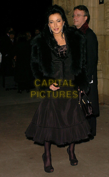 NANCY DELL'OLIO.Pakistan Earthquake Appeal Concert & Fashion Show, held at Royal Albert Hall, London..UK, United Kingdom..13th December 2005..Ref: CAN.full length black flared skirt fur jacket peep toe shoes handbag bag pout pouting.www.capitalpictures.com.sales@capitalpictures.com.©Capital Pictures