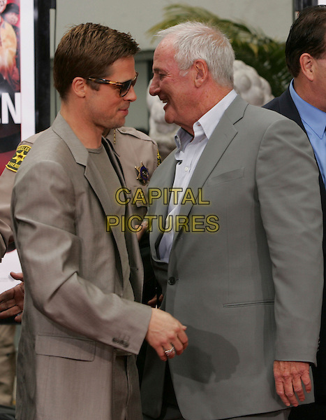 BRAD PITT & JERRY WEINTRAUB .The Warner Brothers Pictures Hand & Foot Print Ceremony for The Cast of Ocean's Thirteen held at The Grauman's Chinese Theatre in Hollywood, California, USA..June 5th, 2007                     .half length beige suit jacket sunglasses shades grey gray profile .CAP/DVS.©Debbie VanStory/Capital Pictures