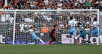 Calcio, Serie A: Lazio vs Roma. Roma, stadio Olimpico, 25 maggio 2015.<br /> Roma's Juan Iturbe, second from left, kicks to score during the Italian Serie A football match between Lazio and Roma at Rome's Olympic stadium, 25 May 2015.<br /> UPDATE IMAGES PRESS/Isabella Bonotto