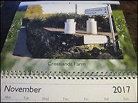 BNPS.co.uk (01202 558833)<br /> Pic: ArchieWorkman/BNPS<br /> <br /> November - Crosslands Farm.<br /> <br /> Madcap Archie Workman is hoping to cream it in with the sales of his new calendar that pays homage to the lost milk churn stands of Britain.<br /> <br /> Archie started photographing the stone-built blocks dairy farmers used to leave their churns on for collecting after uncovering one while working as a lengthsman - someone who maintains grass verges.<br /> <br /> The forgotten structures, that are about 2ft tall, went out of use in 1979 and most have become covered in brambles and weeds since then.<br /> <br /> Archie, 60, has now immortalised 12 of them in a new 2017 calendar which is a contender for the dullest one ever made.