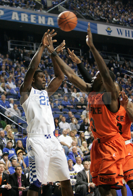 University of Kentucky junior guard Alex Poythress (22) passes the ball against heavy defense during the first half of the UK men's exhibition basketball game vs. the University of Pikeville at Rupp Arena in Lexington, Ky., on Sunday, November 2, 2014. UK won 116-68. Photo by Tessa Lighty | Staff