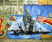 &copy;Si Barber 07739 472 922<br /> Mural on a wall in Manchester depicting the 911 attacks