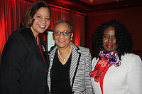 NWA Democrat-Gazette/CARIN SCHOPPMEYER Stephanie Adams, Fayetteville Alumnae Chapter of Delta Sigma Theta president (from left), Carolyn Allen and Macadda Peoples visit at Crimson and Cream.