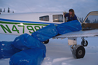 Unloading Straw from Plane Skwentna Chkpt Iditarod 99 Anchorage Diana Moroney