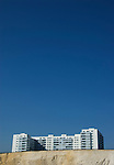 Hotel on cliff tops under blue sky at Brighton, East Sussex, England