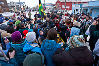 The first ever Jamaican musher, Newton Marshall, is surrounded by a crowd at the Nome finish line during the 2010 Iditarod