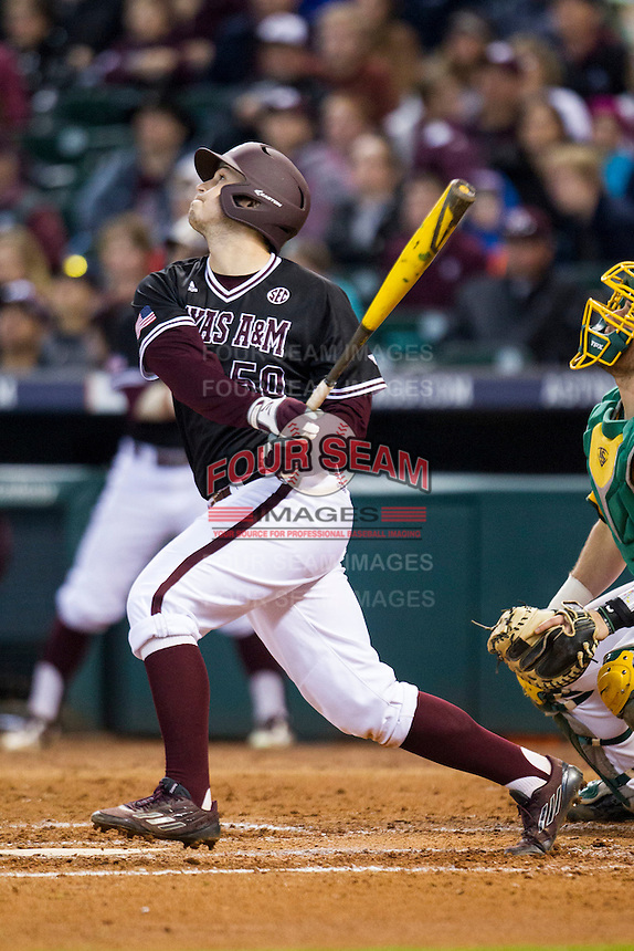 Texas A&M Aggies third baseman Hunter Melton (50) follows through on his swing during the Houston College Classic against the Baylor Bears on March 8, 2015 at Minute Maid Park in Houston, Texas. Texas A&M defeated Baylor 3-2. (Andrew Woolley/Four Seam Images)