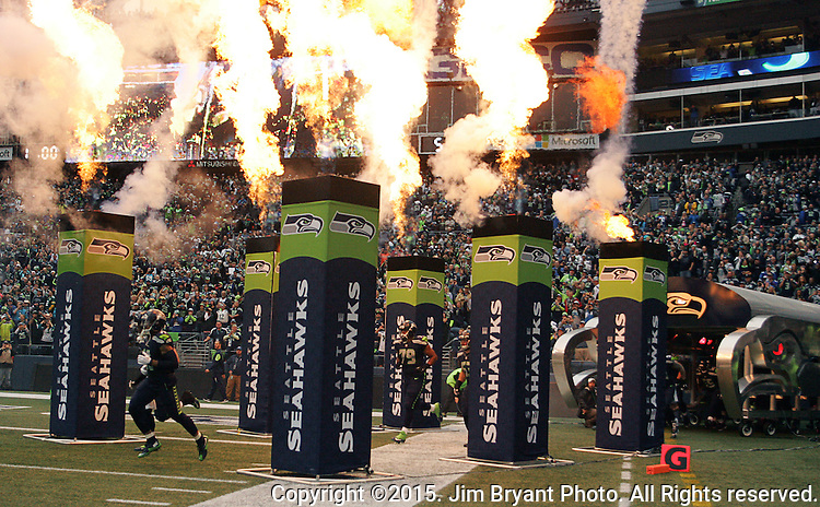 Seattle Seahawks  run onto the field during team introductions before their game against the Carolina Panthers  at CenturyLink Field in Seattle on October 18, 2015. The Panthers came from behind with 32 seconds remaining in the 4th Quarter to beat the Seahawks 27-23.  ©2015 Jim Bryant Photography. All Rights Reserved.