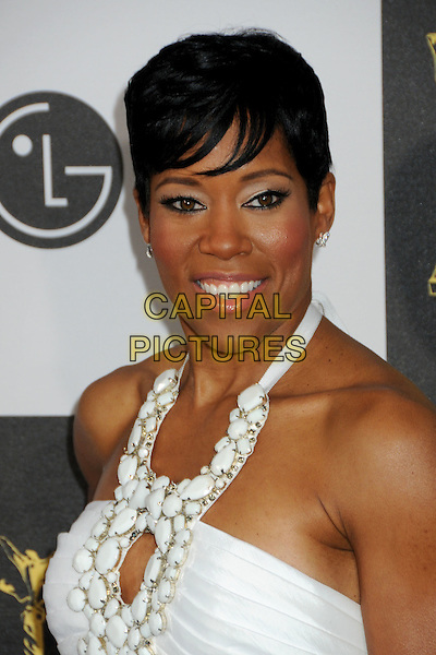REGINA KING.25th Annual Film Independent Spirit Awards - Arrivals held at the Nokia Event Deck at L.A. Live, Los Angeles, California, USA..March 5th, 2010.headshot portrait white halterneck cut out embellished earrings smiling.CAP/ADM/BP.©Byron Purvis/AdMedia/Capital Pictures.