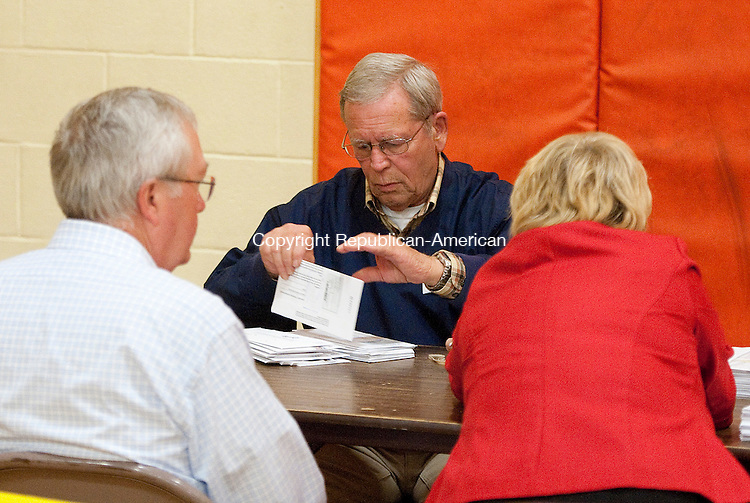 WINSTED,  CT-110816JS04- Craig Closson, center, along with fellow moderators, prepare to count absentee ballots during election day Tuesday at Pearson Middle School in Winsted <br /> Jim Shannon Republican American