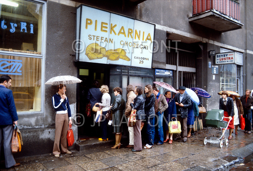 Poland, September, 1981 - People line up outside a bakery in Warsaw. Because most of what is grown in Poland is distributed elsewhere in the USSR, shoppers endure long lines and shortages of nearly everything.