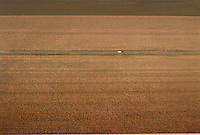aerial view of lonely car in field