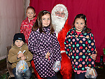 Eoin, Niamh and Aoife Lynch and Fiona O'Malley pictured with Santa when he paid a visit to Slane. Photo:Colin Bell/pressphotos.ie