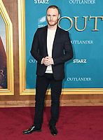 "13 February 2020 - Los Angeles, California - Yan Tual. ""Outlander"" Season 5 Los Angeles Premiere held at the Hollywood Palladium. Photo Credit: Birdie Thompson/AdMedia"
