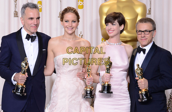 Daniel Day Lewis, Jennifer Lawrence, Anne Hathaway, Christoph Waltz.85th Annual Academy Awards held at the Dolby Theatre at Hollywood & Highland Center, Hollywood, California, USA..February 24th, 2013.pressroom oscars half length black tuxedo bow tie beard facial hair white  shirt award trophy trophies winner winners white pink pale strapless dress trophies winners glasses .CAP/ADM/RE.©Russ Elliot/AdMedia/Capital Pictures.
