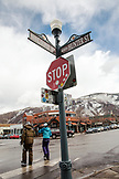 USA, Colorado, Aspen, skiers walk through downtown Aspen at the end of the day, Aspen Ski Resort