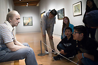 NWA Democrat-Gazette/CHARLIE KAIJO Students from Holy Family Cathedral School of Tulsa, Okla. (right) look at an art piece called &quot;Man on a Bench&quot;, Friday, March 2, 2018 at Crystal Bridges in Bentonvile.<br />