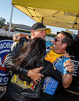 Nov 13, 2016; Pomona, CA, USA; NHRA pro stock motorcycle rider Jerry Savoie celebrates with crew chief after clinching the 2016 pro stock motorcycle world championship during the Auto Club Finals at Auto Club Raceway at Pomona. Mandatory Credit: Mark J. Rebilas-USA TODAY Sports