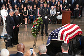 United States Senate Minority Leader Chuck Schumer (Democrat of New York), left, and US Senate Majority Leader Mitch McConnell (Republican of Kentucky), right, lay a wreath during the Lying in State ceremony honoring the late United States Senator John McCain (Republican of Arizona) in the US Capitol Rotunda in Washington, DC on Friday, August 31, 2018.<br /> Credit: Ron Sachs / CNP<br /> <br /> (RESTRICTION: NO New York or New Jersey Newspapers or newspapers within a 75 mile radius of New York City)