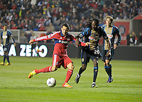 Chicago Fire midfielder Marco Pappa (16) dribbles in for the shot while being defended by Philadelphia Union midfielder Keon Daniel (26).  The Chicago Fire defeated the Philadelphia Union 1-0 at Toyota Park in Bridgeview, IL on March 24, 2012.
