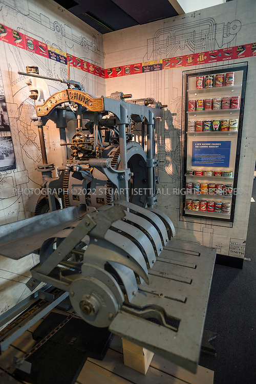 "9/13/2012--Seattle, WA, USA..The Iron Chink at MOHAI...In 1903, the Iron Chink changed the production process for canned salmon. Before the Iron Chink, Chinese cannery workers manually butchered and canned salmon. This machine, however, cut the fish open, separated the fins, and cleaned out the guts. The Iron Chink drastically cut the processing time, while simultaneously taking away the jobs of Chinese workers....The Museum of History and Industry (MOHAI) will open later in 2012 in the former Naval Reserve Training Center, or ""Armory,"" in Seattle's South Lake Union neighborhood...Accredited by the American Association of Museums, MOHAI is ""dedicated to enriching lives by preserving, sharing and teaching the diverse history of Seattle, the Puget Sound region and the nation.""..Exhibits include Boeing B-1 seaplane (Boeing's first plane), the Rainier Brewing Company's old red ""R"" sign and Slo-Mo-Shun IV Hydroplane. MOHAI has around 4 million objects in the collection, including around 100,000 artifacts, and 1.5 million photographs, and extensive archives. Collections focus on Seattle's early settlement (ca. 1850) through present-day, and concentrate on the stories and achievements of Seattle's residents...©2012 Stuart Isett. All rights reserved."