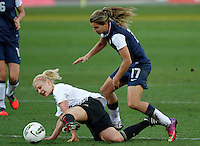 USA's Tobin Heath fights for the ball with Germany's player during their Algarve Women's Cup soccer match at Algarve stadium in Faro, March 13, 2013.  .