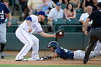 Round Rock Express third baseman Chris Davis #19 attempts to tag out a baserunner during a game against the New Orleans Zephyrs at the Dell Diamond on July 21, 2011 in Round Rock, Texas.  New Orleans defeated Round Rock 7-4.  (Andrew Woolley/Four Seam Images)