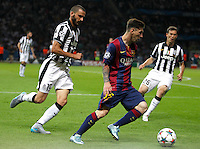 Calcio, finale di Champions League Juventus vs Barcellona all'Olympiastadion di Berlino, 6 giugno 2015.<br /> FC Barcelona's Lionel Messi, right, is chased by Juventus' Leonardo Bonucci during the Champions League football final between Juventus Turin and FC Barcelona, at Berlin's Olympiastadion, 6 June 2015. Barcelona won 3-1.<br /> UPDATE IMAGES PRESS/Isabella Bonotto
