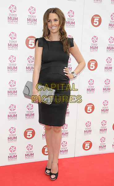 Danielle O'Hara ( nee Lloyd ).attended the Tesco Mum Of The Year Awards 2013, Savoy Hotel, The Strand, London, England..March 3rd, 2013.full length   dress black hand on hip grey gray clutch bag pregnant .CAP/CAN.©Can Nguyen/Capital Pictures.