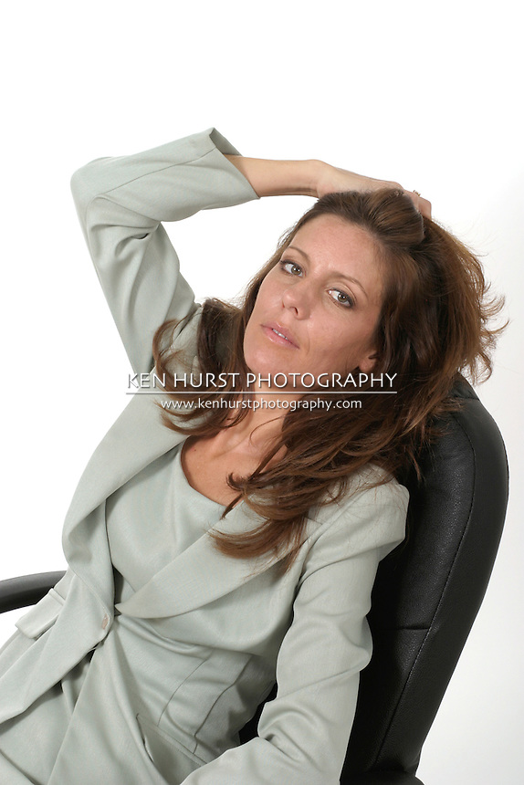 Executive business woman exhausted from a long day of work relaxing in her office chair.