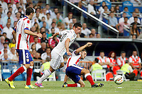 James of Real Madrid and Godin and Koke of Atletico de Madrid during La Liga match between Real Madrid and Atletico de Madrid at Santiago Bernabeu stadium in Madrid, Spain. September 13, 2014. (ALTERPHOTOS/Caro Marin)