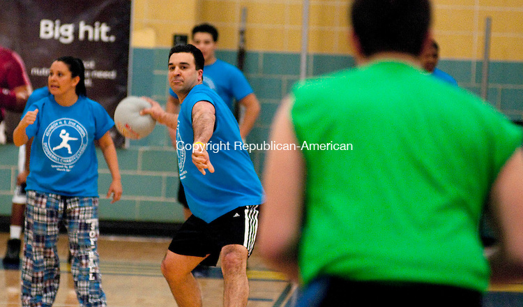 WATERBURY CT, 01 APRIL 2011-040111JS03--Kennedy High School Principal Michael Yamin participates in the Kennedy High School DECA marketing club' 2nd dodge ball tournament at the school. Teams of students and staff battled for the honor of naming the charity to receive proceeds from the night's ticket and concession sales. <br /> Jim Shannon/Republican-American