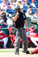 Home plate umpire Eric Cooper during a spring training game between the Philadelphia Phillies and Dominican Republic at Bright House Field on March 5, 2013 in Clearwater, Florida.  The Dominican defeated Philadelphia 15-2.  (Mike Janes/Four Seam Images)