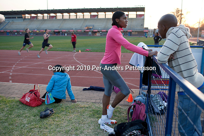 PRETORIA, SOUTH AFRICA - AUGUST 10: Caster Semenya (c), age 19, relaxes after a training at the High Performance Center at the university of Pretoria on August 10, 2010 in Pretoria, South Africa. Caster Semenya won the 800 meters world championship gold medal in Berlin in 2009 was recently cleared to run after her career was held back due to gender testing. She grew up in a rural village in Limpopo, northern South Africa, and she started running only a few years ago, and quickly appeared from nowhere to the world stage. After being banned for almost a year she was cleared by the IAAF and cleared to compete in July 2010. (Photo by Per-Anders Pettersson/Getty Images)