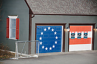 "Campaign signs adorn garage doors painted in the style of the 13-star ""Betsy Ross"" American flag as Democratic presidential candidate Senator Cory Booker (D-NJ) speaks at a house party at the home of State Senator Shannon Chandley and Tom Silva in Amherst, New Hampshire, USA, on Sat., Apr. 6, 2019."