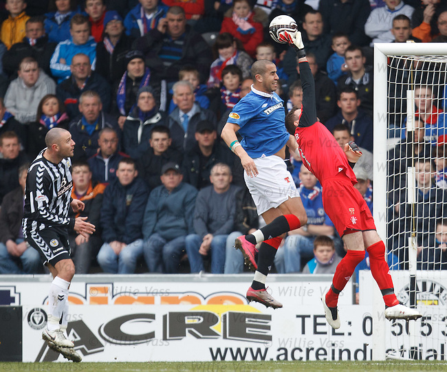 Allan McGregor pushes a cros ball away to safety as Michael Higdon hovers in the distance