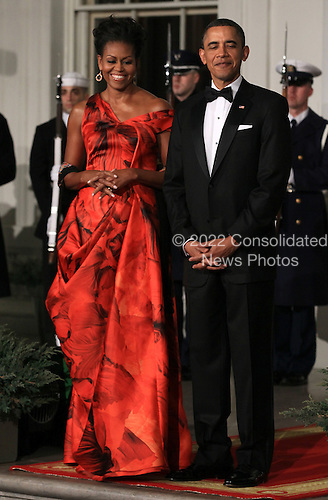 United States President Barack Obama (R) and first lady Michelle Obama (L) welcome President Hu Jintao of China for a State dinner at the White House, Wednesday, January 19, 2011 in Washington, DC. Obama and Hu met in the Oval Office earlier in the day.  .Credit: Win McNamee / Pool via CNP