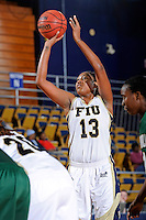 11 November 2011:  FIU's Diamond Ashmore (13) shoots a free throw in the second half as the FIU Golden Panthers defeated the Jacksonville University Dolphins, 63-37, at the U.S. Century Bank Arena in Miami, Florida.