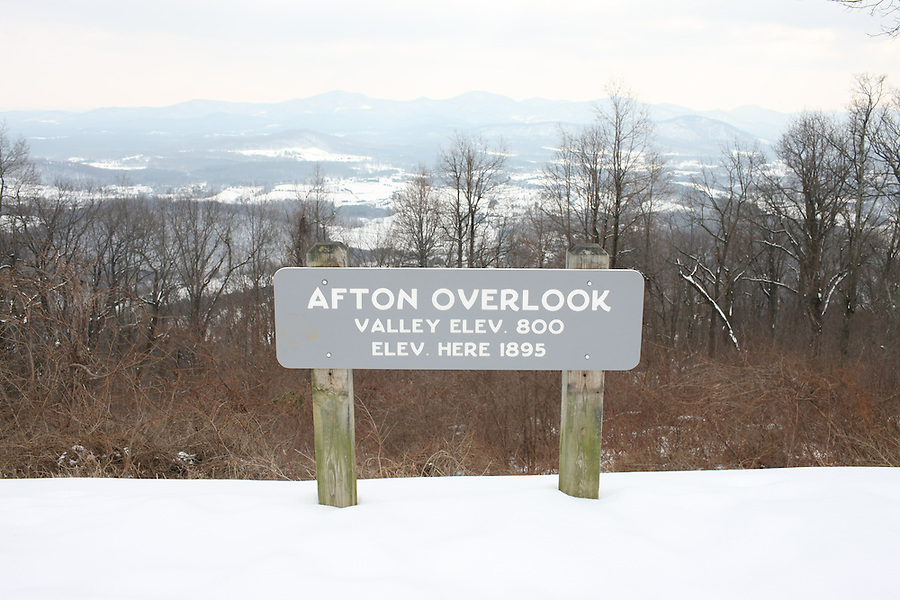 The Blue Ridge Parkway in snow near the Afton Overlook in Nelson County, VA.