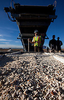 A worker is seen with a shovel next to crushed confiscated ivory, estimated by US wildlife officials to be from around 2,000 elephants, is crushed at the National Wildlife Property Repository, Denver, Colorado, United States, 14 November 2013. The United States Fish and Wildlife Service destroyed their entire stockpile of seized ivory dating back to the 1980's by using a rock crushing machine to send a strong signal to poachers in Africa, and consumers in Asia and the United States, that the US government will not tolerate ivory trafficking. Elephant populations are in steep decline due to poaching and rampant demand, mostly from China, but also the US. The US confiscated ivory destruction follows similar symbolic events in the Gabon, Kenya and Philippines.