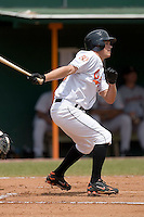 Nicholas Ray (12) of the Bluefield Orioles follows through on his swing at Bowen Field in Bluefield, WV, Sunday July 6, 2008. (Photo by Brian Westerholt / Four Seam Images)